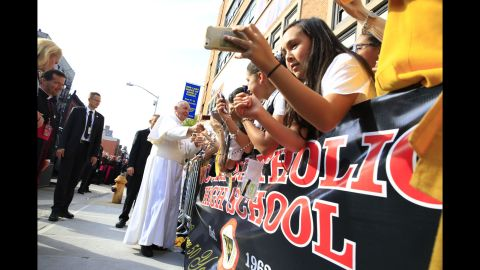 Pope Francis greets the crowd in New York's East Harlem Neighborhood on September 25.