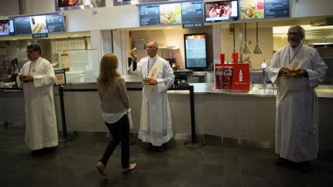 The faithful receive communion at the snack bar during Mass at Madison Square Garden on September 25.