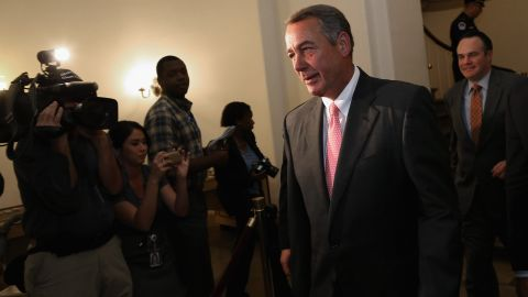 Then-House Speaker John Boehner, an Ohio Republican, heads to a news conference where he would go on to announce that he is retiring from the House in fall 2015 in Washington, DC.