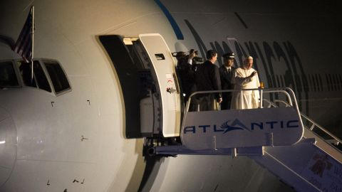 Pope Francis waves to the crowd at Philadelphia International Airport in Philadelphia as he departs for Rome on Sunday, Sept. 27, 2015. Pope Francis wrapped up his 10-day trip to Cuba and the United States on Sunday. (AP Photo/Laurence Kesterson, pool)