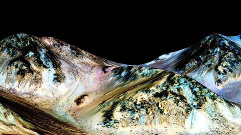 Water still flows across the surface of Mars from time to time, NASA scientists said in 2015. In the photo above, dark, narrow streaks called recurring slope lineae are seen flowing downhill on Mars. Scientists have inferred that they were formed by contemporary flowing water.