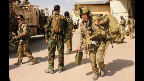 Afghan special forces prepare to launch an operation to retake the city of Kunduz, Afghanistan, from Taliban insurgents on Tuesday, September 29.