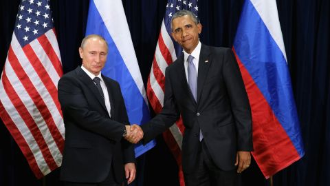 Obama and Putin shake hands while posing for a photo ahead of their meeting at U.N. headquarters on September 28 in New York.