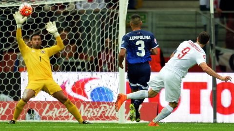 Lewandowski finds the net twice for Poland in an 8-1 thrashing of Gibraltar.
