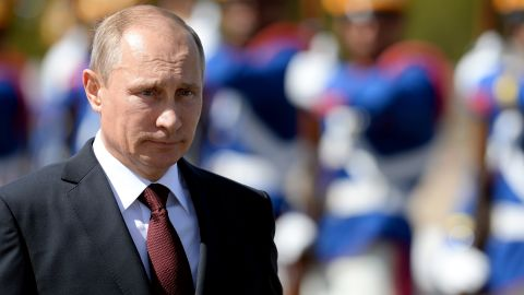 Russian President Vladimir Putin receives military honours during the welcoming ceremony at Planalto Palace in Brasilia on July 14, 2014. Putin is in Brazil to attend the BRICS summit. AFP PHOTO/EVARISTO SA        (Photo credit should read EVARISTO SA/AFP/Getty Images)