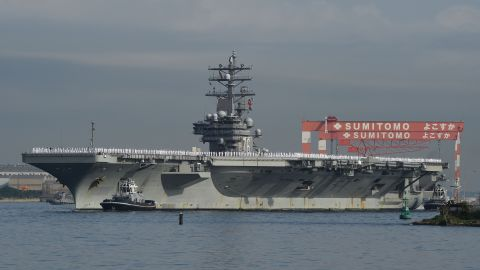The Nimitz-class aircraft carrier USS Ronald Reagan (CVN 76) arrives at the U.S. Navy base in Yokosuka, a suburb of Tokyo, Japan, on October 1, 2015. The Reagan is the fifth U.S. carrier forward deployed to Japan following USS George Washington (CVN 73), USS Kitty Hawk (CV 63), USS Independence (CV 62) and USS Midway (CV 41), according to the Navy.