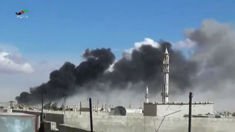 Smoke rises after airstrikes by Russian jets in Talbiseh, western Syria, on September 30, 2015.