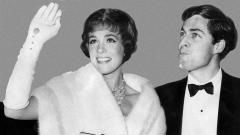 """Andrews arrives at the Oscars with her husband, Tony Walton, in 1965. She would leave the ceremony with the Best Actress award for her role in """"Mary Poppins."""""""