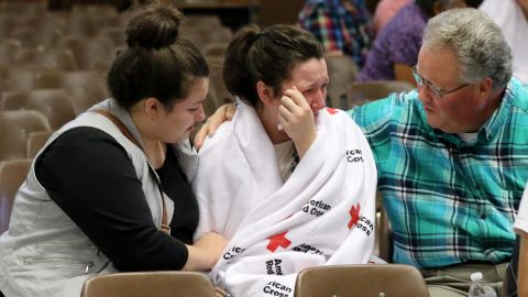 Hannah Miles, center, is reunited with her sister Hailey and father, Gary, on October 1.