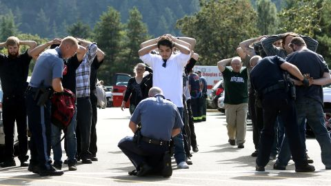 """Police search students outside Umpqua Community College after <a href=""""http://www.cnn.com/2015/10/01/us/gallery/oregon-shooting-umpqua-community-college/index.html"""" target=""""_blank"""">a deadly shooting</a> at the school in Roseburg, Oregon, in October 2015. Nine people were killed and at least nine were injured, police said. The gunman, Chris Harper-Mercer, committed suicide after exchanging gunfire with officers, a sheriff said."""