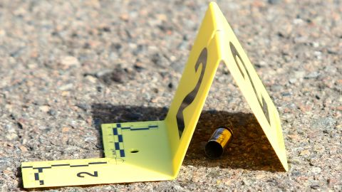 A bullet casing is marked at the scene of the shooting on October 1.