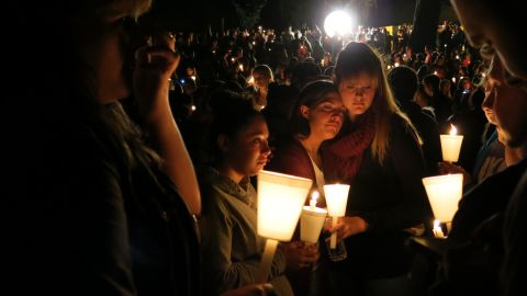 Community members attend a candlelight vigil at Stewart Park for those killed during a shooting at Umpqua Community College in Roseburg, Oregon, on Thursday, October 1. The massacre left nine people dead and nine wounded. The gunman also died.