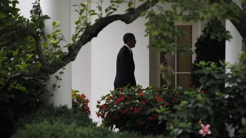 Obama walks back to the Oval Office of the White House in July 2012. Obama cut short a campaign stop in Florida in the aftermath of the mass shooting at a movie theater in Aurora, Colorado. Twelve moviegoers were killed and 70 were injured by convicted shooter James E. Holmes.
