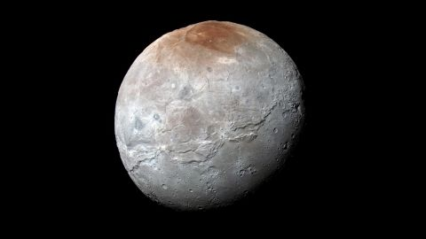 """<a href=""""http://www.nasa.gov/feature/pluto-s-big-moon-charon-reveals-a-colorful-and-violent-history"""" target=""""_blank"""" target=""""_blank"""">Pluto's largest moon, Charon</a>, in seen in enhanced color in this image taken by NASA's New Horizons spacecraft. The space probe took the image just before it made its closest approach on July 14. The image combines blue, red and infrared images to best highlight the moon's surface features. Charon is 754 miles (1,214 kilometers) across. The image was released on October 1."""