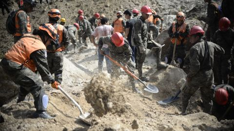 Army soldiers and rescuers search for victims on October 2.