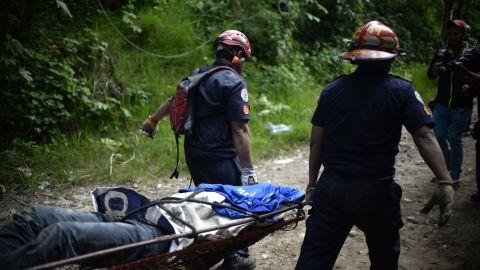 Rescuers carry a landslide victim on October 2.