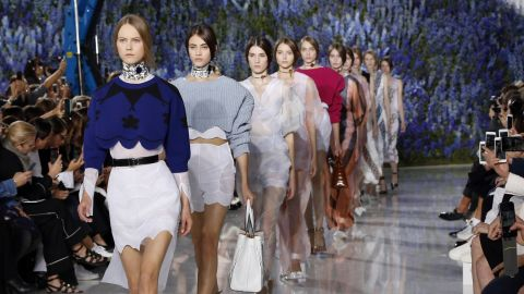 Raf Simons covered the Christian Dior show tent -- on the grounds of the Louvre -- with 300,000 delphiniums. The collection was hardly garden-variety though.