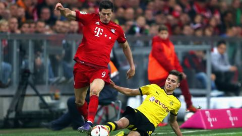 Lewandowski scores twice in Bayern's 5-1 demolition of his former club Borussia Dortmund to take his tally to 12 in as many days. Nine of those came in three league games as Bayern went seven points clear at the top of the Bundesliga. He joined Gerd Muller and Christian Muller as the only players to have netted 12 goals in eight league games.