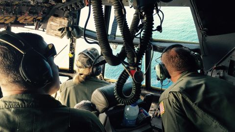 From left, Petty Officer 1st Class Jim Fielder, the plane's engineer, Lt. Heather Majeska, a copilot, and Petty Officer 3rd Class Anders Forsberg, who operated the plane's communications, search for debris. Despite the wealth of technology involved in the search for El Faro survivors, eyes are still one of the most important tools in the search, and everyone is expected to keep a look out.