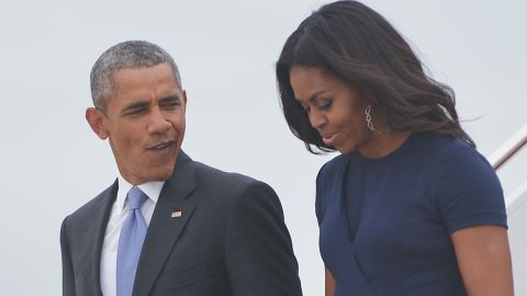US President Barack Obama and First Lady Michelle Obama step off Air Force One upon arrival at Andrews Air Force Base in Maryland on September 29, 2015.