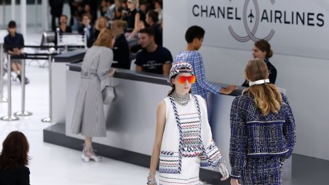 Karl Lagerfeld delivered the most inventive, immersive set of the week with his full-scale Chanel Airlines terminal. (Note the ridiculously slick aviators on the model.)