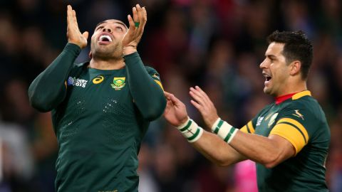 Habana celebrates with Morne Steyn after scoring his second try, and South Africa's sixth of 10 for the match.