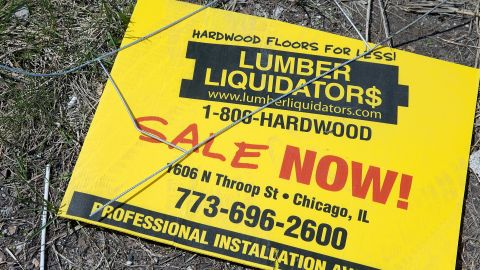 : A sign advertising a sale sits outside a Lumber Liquidators store on April 29, 2015 in Chicago, Illinois.