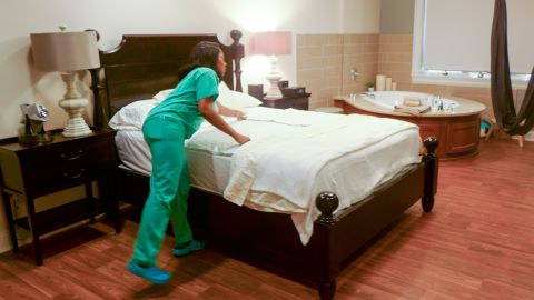 At the Greenville Health System Midwifery Care and Birth Center in Greenville, S.C., women get a plush king size bed, a giant tub and cloth swing to assist them with labor. The room has hardwood floors, mood lighting and high tech sound systems. The center is located in a medical park across the street from the main Greenville hospital.