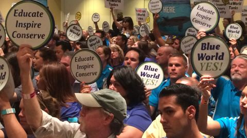 """Supporters of the SeaWorld project carried signs reading """"Blue World Yes!"""""""