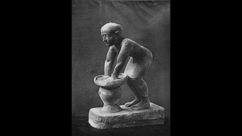 Bread and beer were staple foods in ancient Egypt and Greece. Pictured is a limestone statuette of an Egyptian servant pressing out the fermented barley-bread from which beer was brewed.