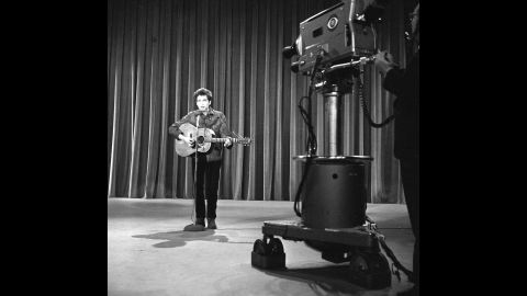 """In 1963, Dylan got the call performers dreamed about: an appearance on """"The Ed Sullivan Show,"""" one of the most popular TV shows in the country. (A year later, <a href=""""http://www.cnn.com/2014/01/30/showbiz/celebrity-news-gossip/beatles-ed-sullivan-50-years-anniversary/"""">Sullivan would introduce the Beatles.)</a> At rehearsals, shown here, Dylan performed """"Talkin' John Birch Paranoid Blues."""" But some CBS brass, <a href=""""http://query.nytimes.com/mem/archive-free/pdf?res=9A06E5D8133CE63ABC4C52DFB3668388679EDE"""" target=""""_blank"""" target=""""_blank"""">worried about controversy</a> over the song's mockery of the right-wing John Birch Society, were nervous, and <a href=""""http://www.history.com/this-day-in-history/bob-dylan-walks-out-on-the-ed-sullivan-show"""" target=""""_blank"""" target=""""_blank"""">Dylan declined to perform something else.</a> He never did appear on """"Sullivan."""""""
