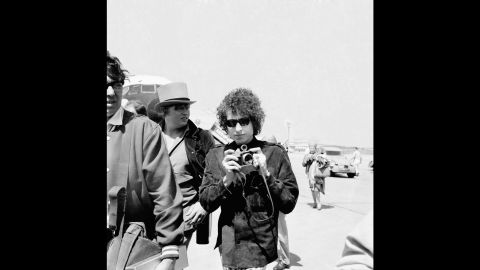 """Many of the concerts were raucous affairs, with audience members yelling at Dylan and Dylan yelling back. (The Manchester, England, show was captured on """"Live 1966: The 'Royal Albert Hall' Concert."""") Dylan left for France on May 22; this photo shows him arriving at Le Bourget Airport in Paris."""