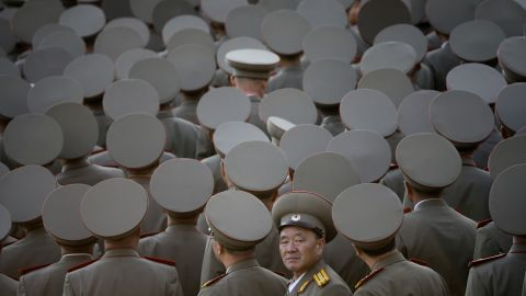 North Korean veterans gather at the start of the parade.