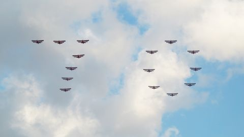 North Korean airplanes fly in formation over  Pyongyang's Kim Il Sung Square, displaying the number 70.