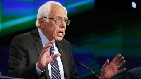 """Sanders speaks during the debate. CNN's Mark Preston said Sanders' opening remarks """"hit on all of the hot-button liberal issues: Take back the government from billionaires, climate change. He all but said it is time for a revolution."""""""
