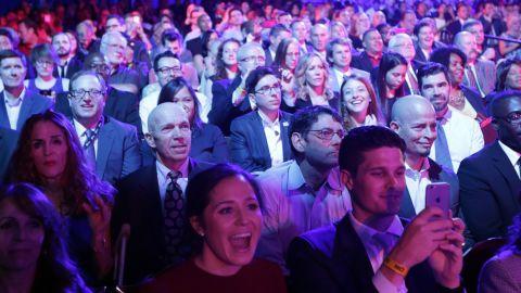Audience members watch the debate.