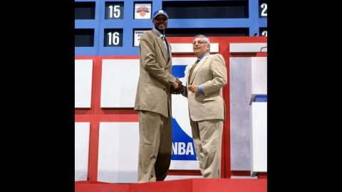 Odom shakes hands with NBA Commissioner David Stern during the 1999 NBA Draft. Odom was drafted by the Los Angeles Clippers.