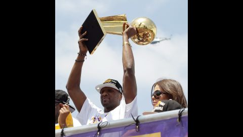 Odom hoists the Larry O'Brien Trophy while riding in the Lakers' victory parade in June 2010. The Lakers defeated the Boston Celtics for a second straight championship.