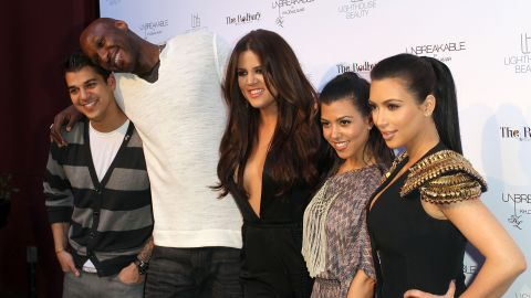 """From left, Rob Kardashian, Odom, Khloe Kardashian, Kourtney Kardashian and Kim Kardashian pose for photographers during an event in Los Angeles in April 2011. Odom was married to Khloe, and he was featured in the reality show """"Keeping Up With the Kardashians"""" as well as the couple's own reality show, """"Khloe & Lamar,"""" which lasted two seasons."""