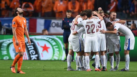 The Czech Republic, which played the second half with 10 men after having a player sent off, qualified in first place ahead of Iceland in second. Turkey's 1-0 win over Iceland means it booked its place in the finals as the best third-place team.