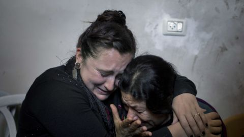 Two Palestinian women cry Wednesday, October 14, during the funeral of Muataz Ibrahim Zawahra, who was killed in clashes with Israeli troops near Bethlehem.