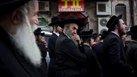 """Ultra-Orthodox Jewish men gather around the body of Yeshayahu Kirshavski during his funeral in Jerusalem on Tuesday, October 13. According to the Times of Israel, Kirshavski was killed by a Palestinian <a href=""""http://www.timesofisrael.com/barkat-joins-thousands-at-funeral-of-jerusalem-attack-victim/"""" target=""""_blank"""" target=""""_blank"""">in a car-ramming attack.</a>"""