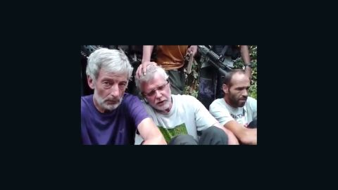 Three men, who appear to be hostages Robert Hall, John Ridsdel and Kjartan Sekkingstad (l-r), are seen in this video screengrab