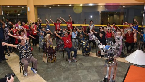The Robocoach leads elderly people at a senior center in Singapore in a series of arm exercises. The Asian city state is rolling out robotic coaches to 25 senior centers as it looks for technological solutions to a fast aging society.