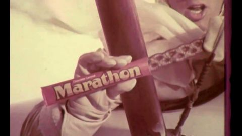 """The Marathon bar took a """"good long time"""" to get through -- and no wonder, given that it was 8 inches of chocolate-covered caramel. But despite its ubiquity in the 1970s (and that of commercial spokesman Marathon John, played by Patrick Wayne), it was phased out in the 1980s. Maybe it took too long to eat."""