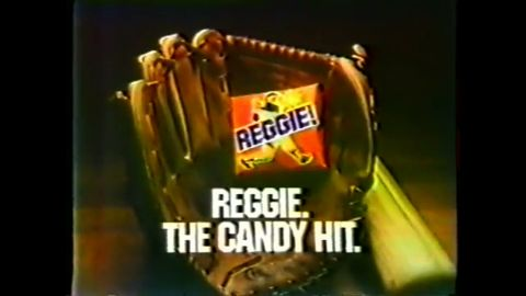 """The Reggie bar was a product of a particular time: late-'70s America, when New York Yankees slugger Reggie Jackson<a href=""""https://www.youtube.com/watch?v=LZNTzxVNv24"""" target=""""_blank"""" target=""""_blank""""> hit three home runs in one 1977 World Series game</a>. By Opening Day 1978, Reggie bars were being handed out at the Yankees' home opener (and <a href=""""http://ftw.usatoday.com/2015/04/reggie-jackson-yankees-candy"""" target=""""_blank"""" target=""""_blank"""">thrown on the field in celebration</a>). The round bar, which consisted of caramel and peanuts in milk chocolate, was gone by the early '80s, though it had a short-lived comeback in the early '90s, when Jackson made the Hall of Fame. Technically, you can still get it under its original name: <a href=""""http://pearsonscandy.com/candy/bun-bar"""" target=""""_blank"""" target=""""_blank"""">the Bun bar</a>."""