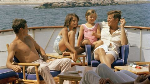 Kennedy sits with Caroline, brother-in-law Steve Smith and niece, Maria Shriver, aboard the presidential yacht Honey Fitz near Hyannis Port, Massachusetts.