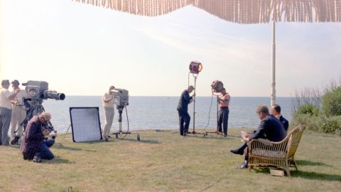 In September 1963, CBS news anchor Walter Cronkite interviews Kennedy for his first half-hour nightly news broadcast.