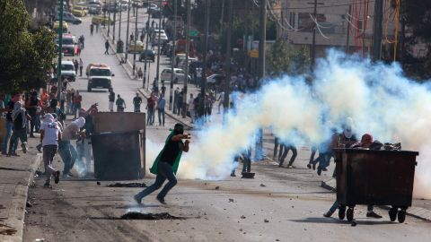 A Palestinian protester uses a slingshot to throw stones toward Israeli security forces during clashes in the West Bank city of Bethlehem on October 16.