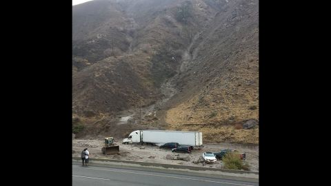"""Efren Munoz Jr. took this photo Thursday when he became stuck in mud on Interstate 5 in the Tehachapi Mountains, a highway known locally as """"the grapevine."""""""